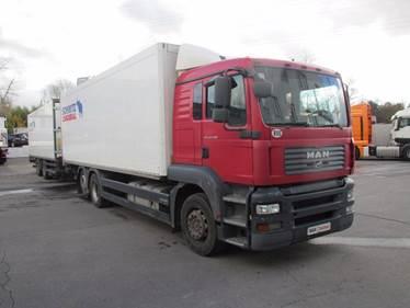 Автопоезд TGA 26.350 6X2-2 BL-WW прицеп Schmitz Cargobull ZKO18